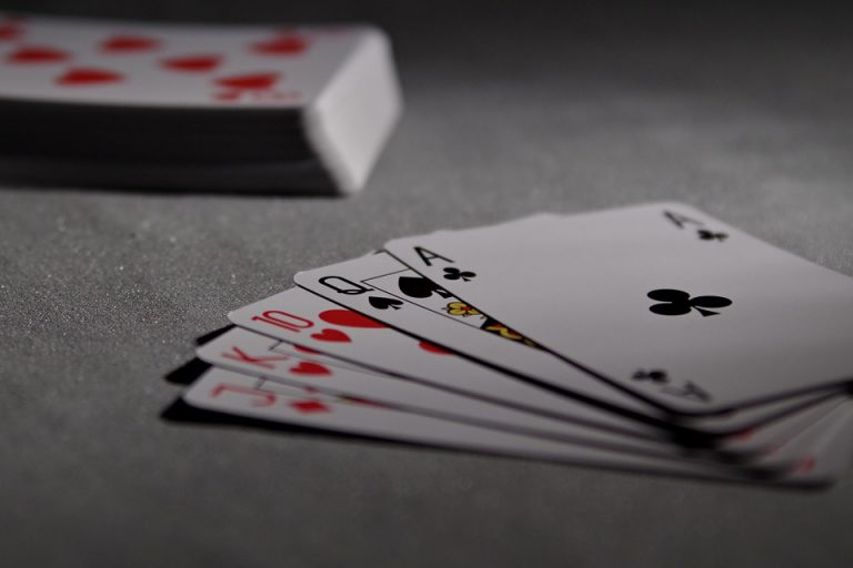 Card Games US playing cards poker bridge game laying on ground - Top Games to Exercise Your Brain