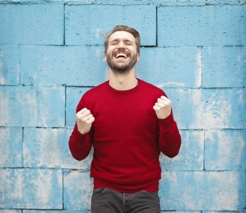 It Releases Happy Chemicals US happy man in red - 4 Reasons Why Sports Make Us Happier