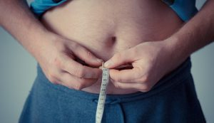 weight gain measuring 300x173 - 4 Biggest Health Risks of a Sedentary Lifestyle and How to Avoid Them